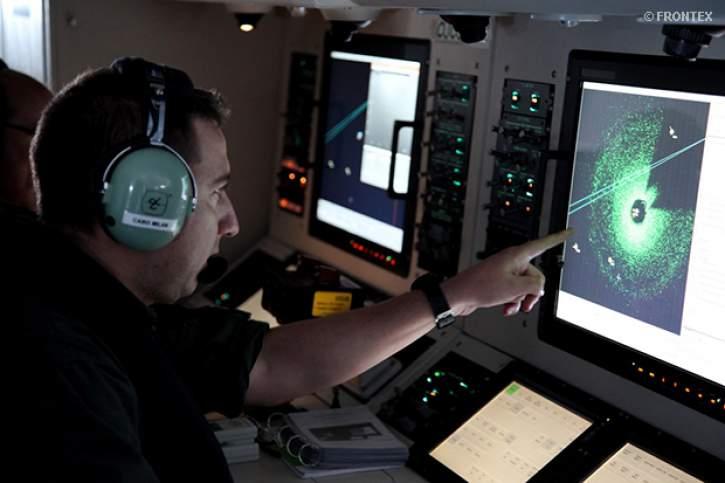 Military officer monitoring a radar screen