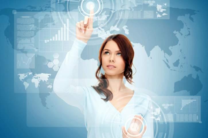 A lady touching a virtual screen.