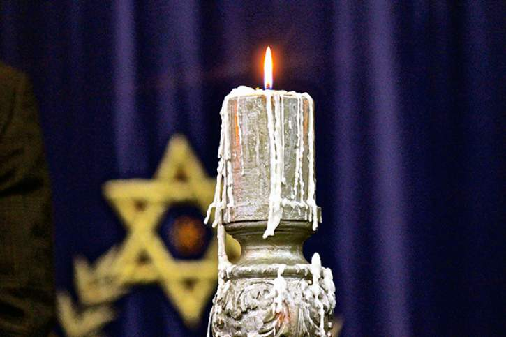 A candle flame following the Yom HaShoah Holocaust Memorial