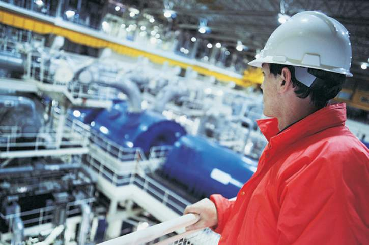 Engineer looking at an energy power station