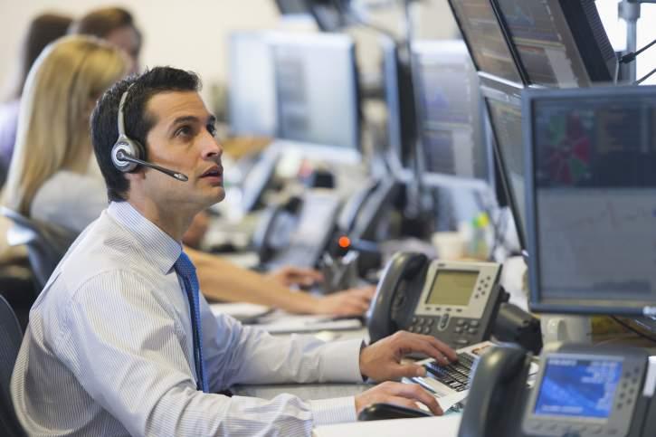 Financial trader looking at computer screen