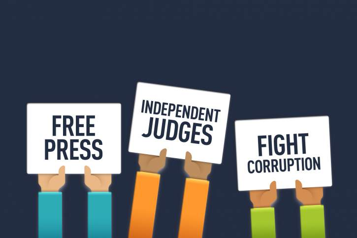 Cartoons of arms holding banners with Free press, independent judges and fight corruption on them
