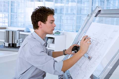 Architect using drafting table