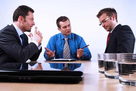 Three businessmen handling negotiations