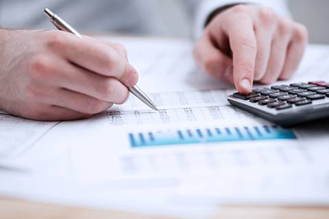 Financial data analyzing. Counting on calculator