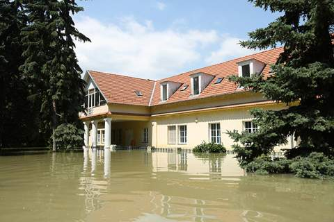 Flooded house in flood waters
