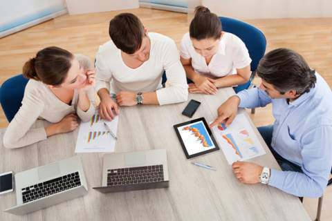 Business Team In Office Meeting