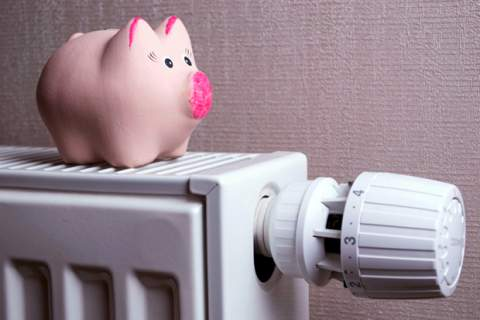 Piggy bank saving electricity and heating costs