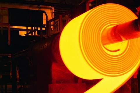 Red-hot roll of steel in steel mill