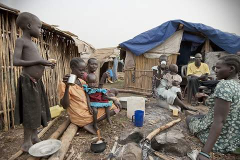 People have breakfast in displaced persons camp, Juba, South Sudan