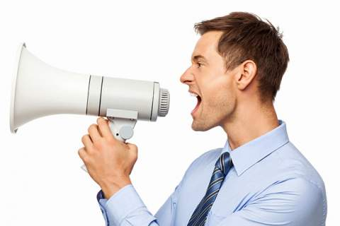 Irritated Businessman Shouting Through Megaphone