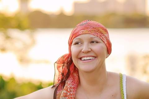 Woman with cancer wearing scarf